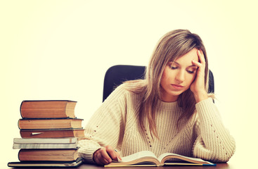 Woman tired because of studying