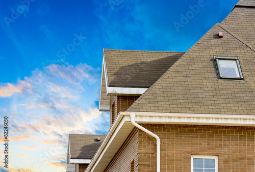 house with a gable roof window poster