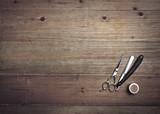 Vintage barber tools on wood background