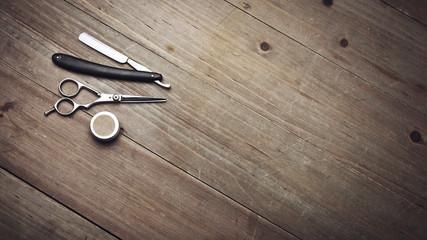 Vintage barber tools on wood table