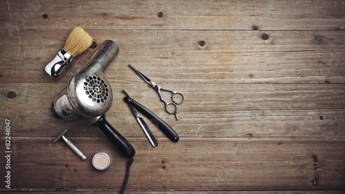 Leinwanddruck Bild Vintage barber equipment on wood desk with place for text