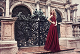 Fototapety Woman in red dress - San Marco Square, Venice, Italy