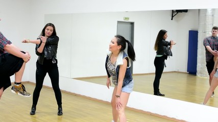 three dancers - group of three friends warm up in hall - mirror