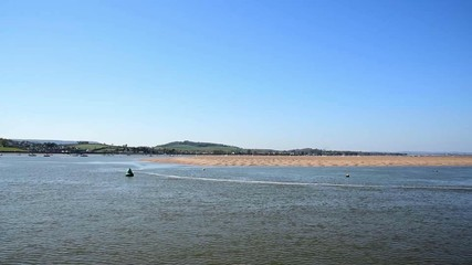 River Exe, view to the riverside from moving boat