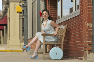pin up girl sitting on a bench