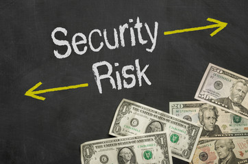 Text on blackboard with money - Security and Risk