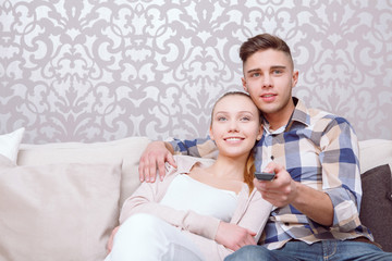 Young beautiful couple on sofa