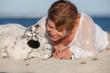 loving dog owner at beach