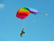 Tandem parachute against clear blue sky - 82259051