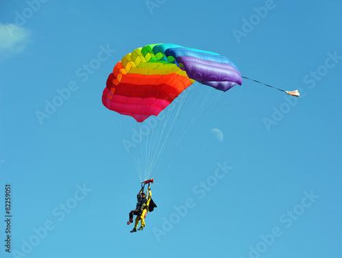 Leinwandbild Motiv Tandem parachute against clear blue sky
