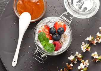 Chia pudding dessert with berries and honey