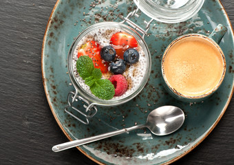 Chia pudding dessert with berries and coffee Espresso. top view