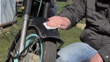 Man clean the old motorcycle