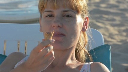 beautiful young woman who enjoy a cone of ice cream