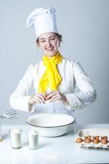 Cook breaking egg