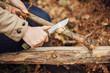 Girl cuts a stick a knife