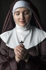 Nun with cross