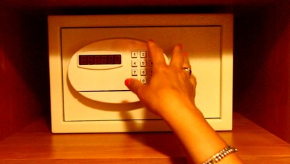 Entering code and removing money from hotel safe