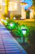 Leinwanddruck Bild - Solar Garden Light, Lanterns In Flower Bed. Garden Design