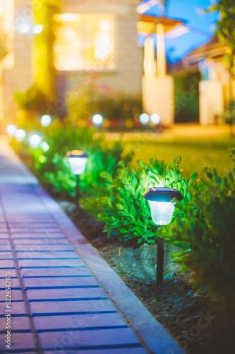 Leinwanddruck Bild Solar Garden Light, Lanterns In Flower Bed. Garden Design