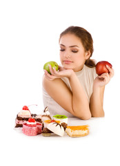Young beautiful women with apples looking at cookies