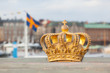 Golden crown with swedish flag on background in Stockholm - 82268833