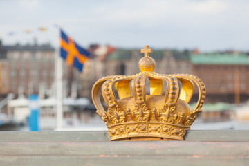Golden crown with swedish flag on background in Stockholm