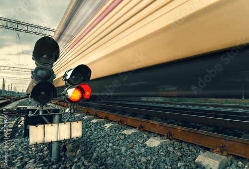 Leinwandbild Motiv High speed passenger train on tracks with motion blur effect at