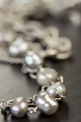 Assorted silver costume jewellery with a jumbled pile