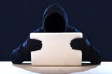 hacker in hood mask with computer hacking system in cybercrime poster