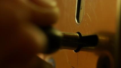 Key sliding into lock and locking \ unlocking door.
