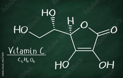 Chemical formula of Vitamin C on a blackboard