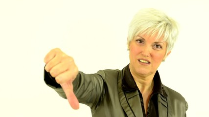 business middle aged woman shows thumb on disagreement
