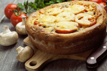 Pie with mushrooms and tomatoes