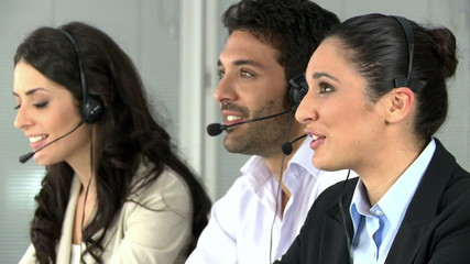Smiling woman working  at call center
