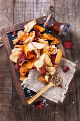 Healthy vegetable chips on a rustic background
