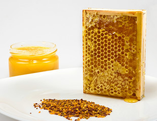 honey, honeycomb and pollen on a plate