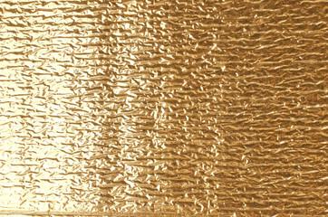 Gold aluminum foil texture.