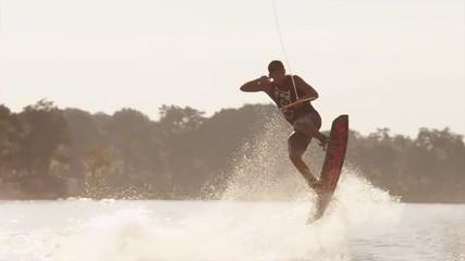 USA, Florida, Orlando, Maitland Lake. Young man on wakeboard