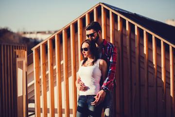 sensual outdoor portrait of fashion couple