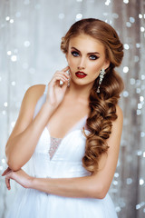 Portrait of Beautiful Bride in Lights. Fashion Dress and MakeUp