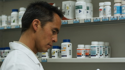 pharmacist selecting medicine
