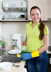 woman washing plates in home