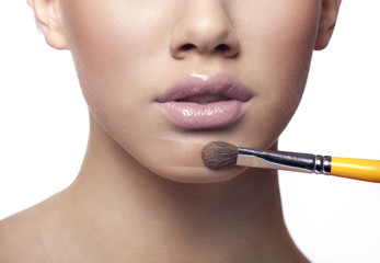 Applying make up liquid powder with brush blusher, powder line v