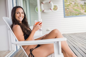 Beautiful woman relaxing and holding drink