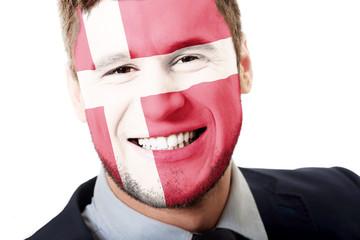 Happy man with Denmark flag on face.