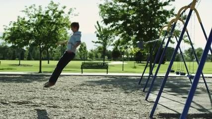 WS PAN Boy (12-13) on swing in park / Orem, Utah, USA