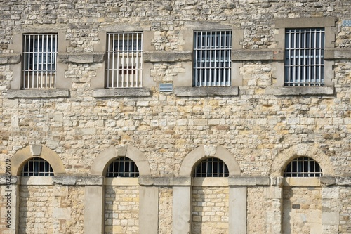 canvas print picture Outside of prison with bars
