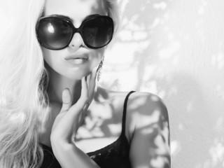 beautiful woman in sunglasses.monochrome blond girl