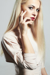 Young Blond woman. manicure.Beautiful girl model.make-up